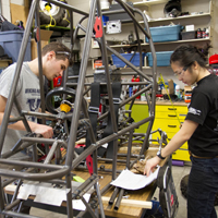 Students working on a vehicle