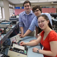 Students working on an electrical board